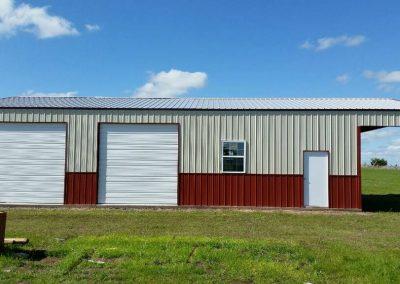 Dual garage welded steel building