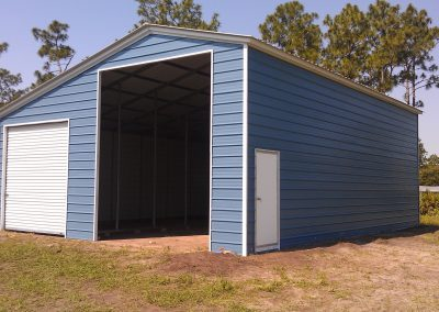 Blue Sloped Metal Barn